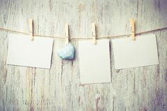 Write some words of love. Blank sheet of paper hand made heart pinned to rope on wooden background Royalty Free Stock Photo