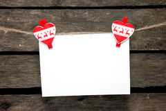 Blank sheet of paper hanging on a clothespins New Year's stock photography