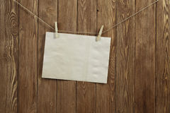 Write your message. Blank sheet of paper hanging on rope Stock Images
