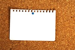 Blank sheet of paper. Horizontal blank sheet of paper on cork board background stock image