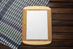 Blank sheet of paper on kitchen table. chef Menu Stock Photography