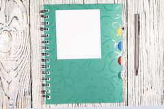 Blank sheet of paper, notepad, pen and other supplies Royalty Free Stock Photo