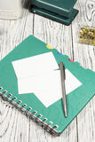 Blank sheet of paper, notepad, pen and other supplies Royalty Free Stock Images