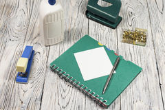 Blank sheet of paper, notepad, pen and other supplies Stock Photo