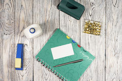 Blank sheet of paper, notepad, pen and other supplies Royalty Free Stock Image
