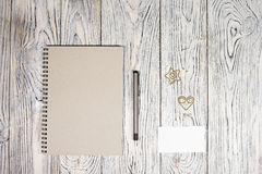 Blank sheet of paper, notepad, pen and other supplies Royalty Free Stock Photography