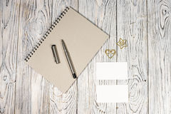 Blank sheet of paper, notepad, pen and other supplies Stock Images