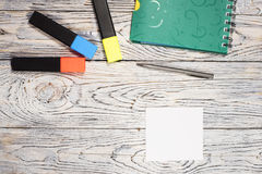 Blank sheet of paper, notepad, pen and other supplies Royalty Free Stock Photos