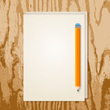 Blank sheet of paper and orange pencil on grunge wooden backgrou Royalty Free Stock Photography