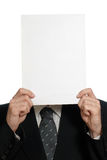 Blank sheet of paper over face Stock Images
