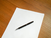 Blank sheet of paper and pen. Royalty Free Stock Images