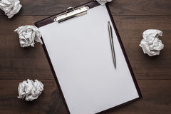Blank sheet of paper and pen creative process concept Stock Image
