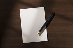 Blank sheet of paper with pen Royalty Free Stock Photos