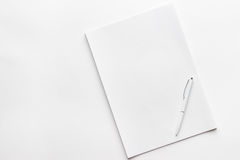 Blank sheet of paper and pen Stock Photo