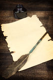Blank sheet of paper and quill Stock Image