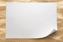 Blank sheet of paper on sand Royalty Free Stock Photo