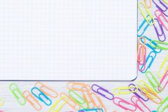 Blank sheet of paper, with scattered around the edges, colorful staples. A blank sheet of paper, with scattered around the edges, colorful staples royalty free stock photography