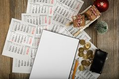 Blank sheet of paper and small purse with coins on the New Year's background. Top view royalty free stock photography