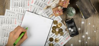 Blank sheet of paper and small purse with coins on the New Year& x27;s background. Top view stock photos