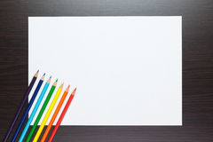 Blank sheet of paper on the table with pencils Royalty Free Stock Image