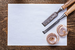 Blank sheet of paper wood scobs firmer chisels construction conc Royalty Free Stock Images