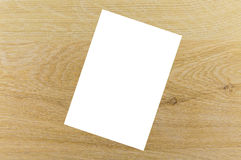 Blank sheet of paper on the wood texture Stock Photos