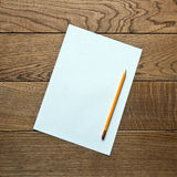 Blank sheet of paper on a wooden background Royalty Free Stock Images