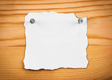 Blank sheet of paper on a wooden board Royalty Free Stock Images