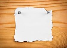 Blank sheet of paper on a wooden board. Blank sheet of paper on  wooden board Royalty Free Stock Images