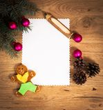 Blank sheet of paper on the wooden floor and Christmas decorations Stock Image