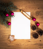 Blank sheet of paper on the wooden floor  and Christmas decorations Stock Images