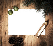 Blank sheet of paper on the wooden floor with a pencil and Christmas decorations Stock Image