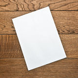 Blank sheet of paper on a wooden table Stock Photos