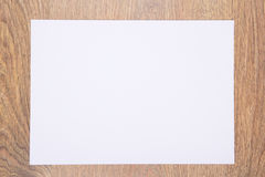 Blank sheet of paper on wooden table stock photo