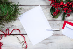 The blank sheet of paper on the wooden table with Royalty Free Stock Image