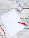 The blank sheet of paper on the wooden table with Royalty Free Stock Photography