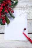 The blank sheet of paper on the wooden table with Royalty Free Stock Images