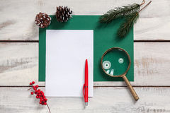 The blank sheet of paper on the wooden table with Royalty Free Stock Photo