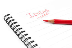 Blank sheet of paper, word Ideas and red pencil Royalty Free Stock Images