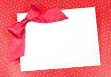 Blank sheet with a red bow Stock Image