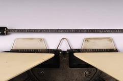Blank Sheet Typewriter. Close up photo of a retro typewriter, with blank paper or sheet Stock Photos