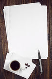 Blank sheet of white paper and coffee Royalty Free Stock Photos