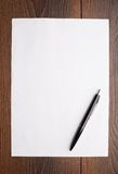 Blank sheet of white paper and pen Royalty Free Stock Images
