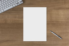 Blank sheet on a wooden table Royalty Free Stock Photo