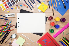 Blank sheets and drawing tools. Top view of wooden desktop with blank paper sheets, drawing tools and stationery. Mock up Stock Photo