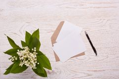 Blank sheets with envelope and flowers. Royalty Free Stock Photos