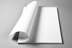 Blank sheets of paper with curled upper page Stock Photos