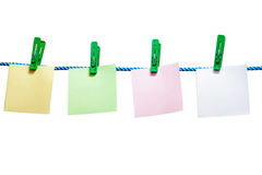 Blank sheets of paper hanging on a rope isolated Royalty Free Stock Images