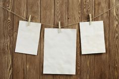Write your message. Blank sheets of paper hanging on rope Royalty Free Stock Images