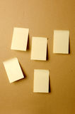 Blank sheets of paper stuck to the wall brown Stock Photography
